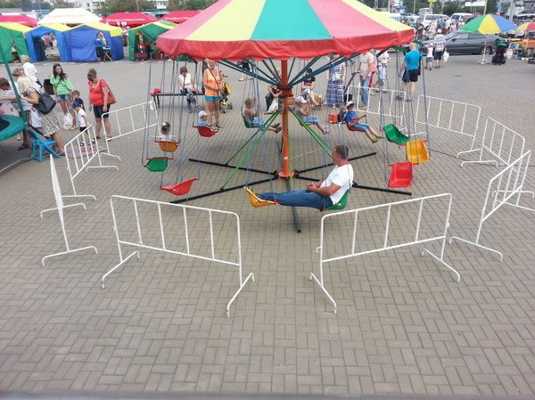 man-on-kids-carnival-swing-ride